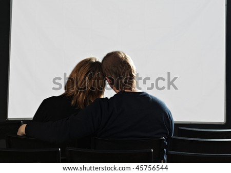 couple in cinema with white screen