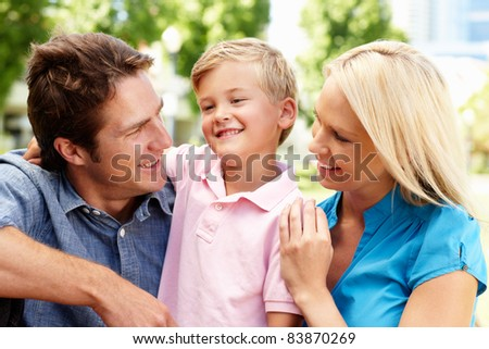 Couple in city park with young son