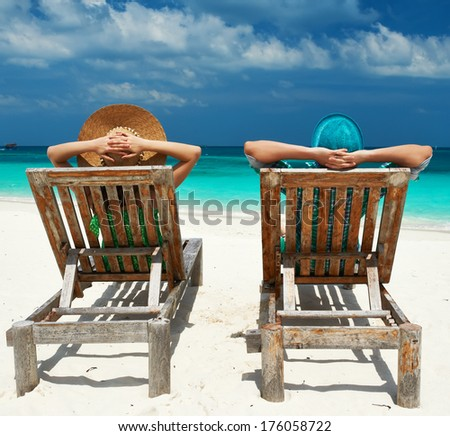 Couple in green on a tropical beach at Maldives #176058722