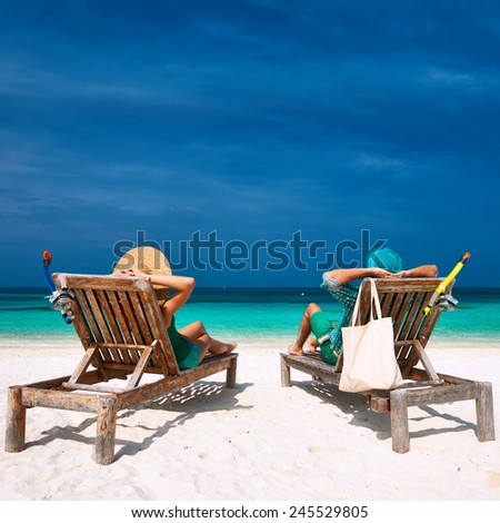 Couple in green relax on a tropical beach at Maldives #245529805