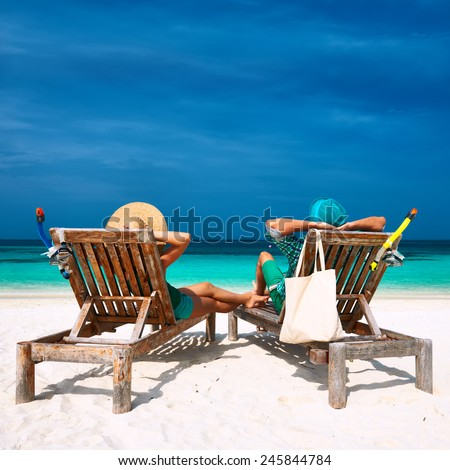 Couple in green relax on a tropical beach at Maldives #245844784