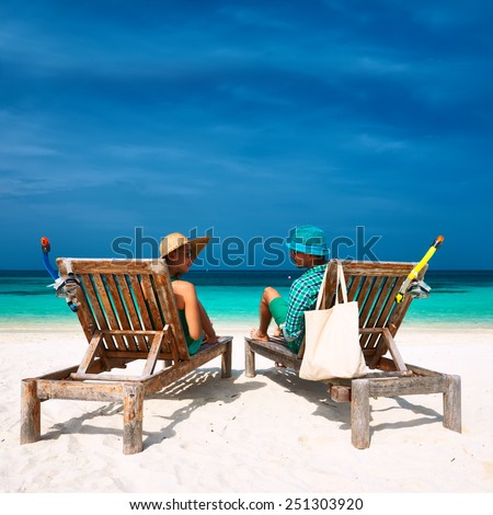 Couple in green relax on a tropical beach at Maldives #251303920