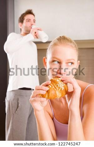 couple in kitchen having breakfast