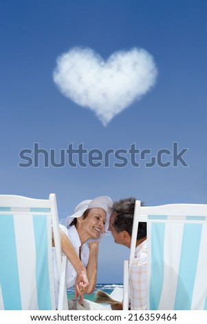 Couple in lounge chairs with heart cloud overhead