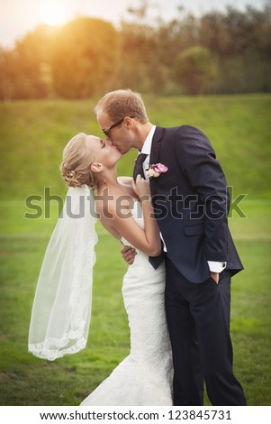 couple in love bride and groom together in wedding summer day enjoy a moment of happiness and love. Beautiful happy newlywed outdoors. handsome man and alluring woman in white dress on nature