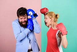 Couple in love competing boxing. Conflict concept. Family life. Complicated relationships. Couple romantic relationships. Man and woman boxing fight. Boxers fighting gloves. Difficult relationships.