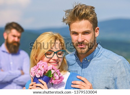 Couple in love dating while jealous bearded man watching wife cheating him with lover. Infidelity concept. Couple romantic date lovers bouquet flowers. Lovers hugs outdoor flirt romance relations. #1379533004