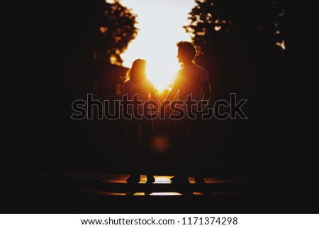 Couple in love enjoying moments during sunset outdoors #1171374298