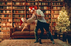 Couple in love feeling happiness about their romance spending Christmas or new year  together, woman and man enjoying perfect relationships and spending winter vacations in cozy home interior.