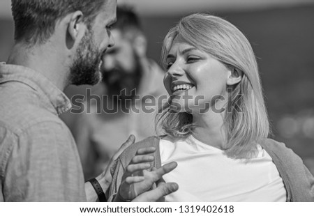Couple in love happy dating, jealous bearded man watching wife cheating him with lover. Couple romantic date lovers flirting. Lovers meeting outdoor flirt romance relations. Jealous concept. #1319402618