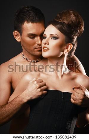 Couple in love. Happy loving couple. Dark background.