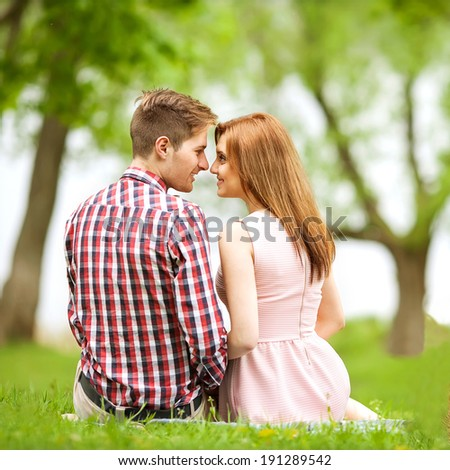 Couple in love in sitting near the river, picnic . Valentine\'s Day