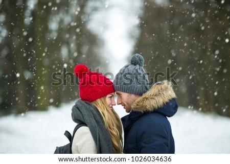 Couple in love in winter scenery