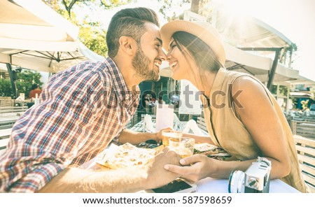 couple in love kissing at bar...
