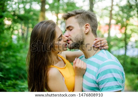 Couple in love kissing with passion outdoors. Man and woman attractive lovers romantic kiss. Passionate kiss concept. Giving kiss. Seduction and foreplay. Sensual kiss of lovely couple close up.