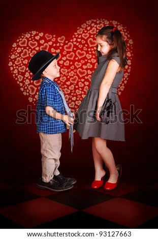 Couple in love of children on the heart valentines background