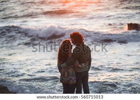 Couple in love on the beach at sunset. Romantic moments together #560715013