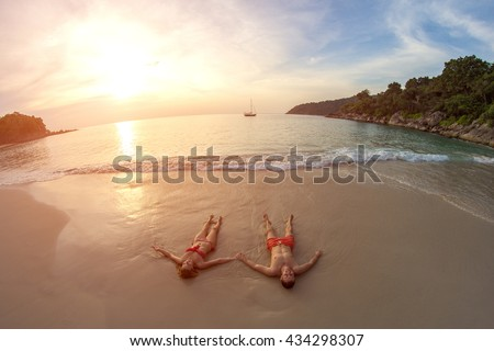 Couple in love on the beach. Sunset. Tropical. Love story. Lost beach. Paradise. Island.