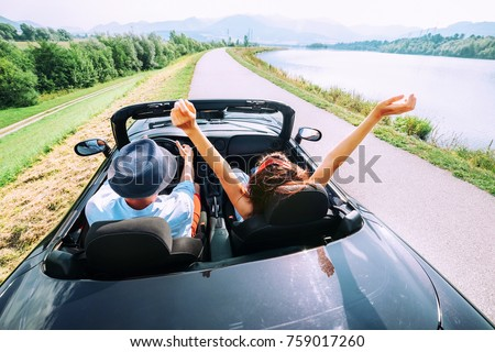 Couple in love ride in cabriolet car