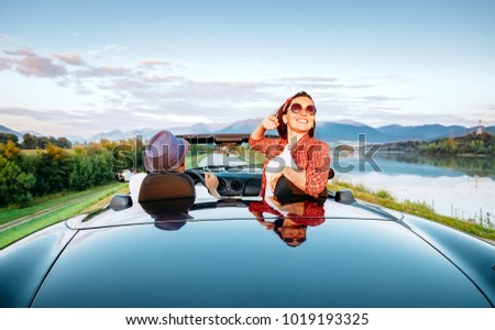 Couple in love ride in cabriolet on the picturesque mountain road