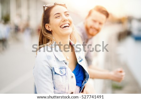 Couple in love sharing emotions in beautiful sunset #527741491