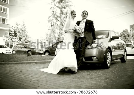 couple in love, the bride and groom standing near a car
