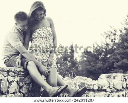 couple in love together summer time outdoors black and white