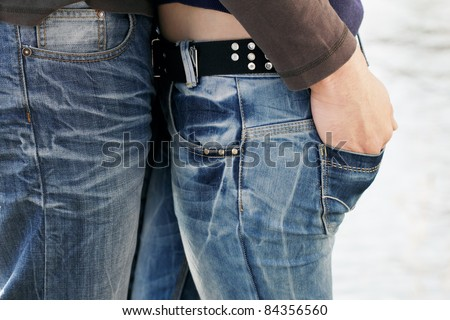 Couple in love, two young people, boy and girl, close together in Jeans. - stock photo
