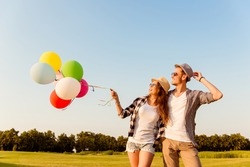 couple in love walking with balloons