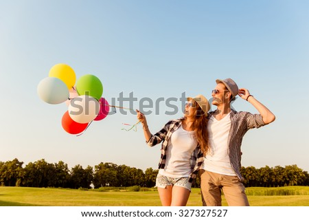 couple in love walking with balloons #327327527