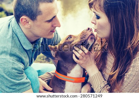 Couple in love with dog nature dog licking man