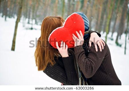 Couple in love with red heart