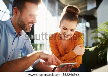 Couple in modern cafe enjoying time together browsing phone #562246966