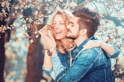 Couple in nature.Happy couple fall in love under a beautiful cherry tree.