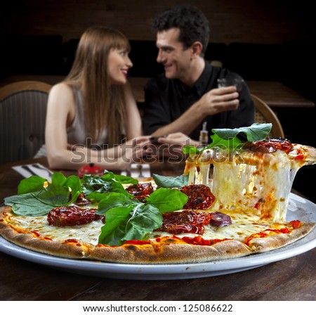 Couple in pizzeria