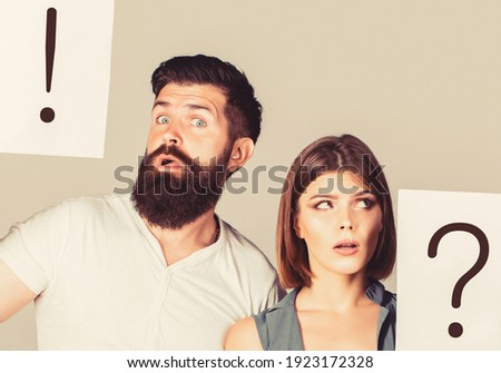 Couple in quarrel. Question mark. A woman and a man a question, exclamation point. Quarrel between two people. Pensive man and a thoughtful woman. Husband and wife not talking, being in quarrel. Stock photo ©