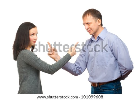 Couple in quarrel. Woman pointing at man, isolated on white background
