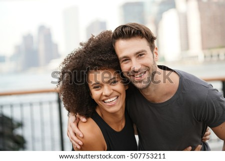 Couple in running outfit embracing each other