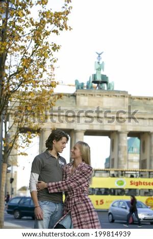 Couple in street, embracing Stock fotó ©