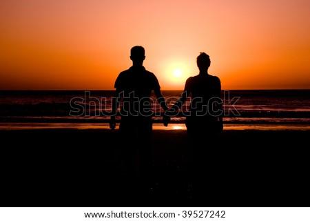 Couple in sunset - stock photo