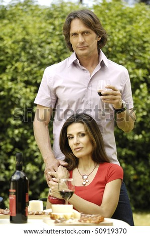 Couple in the garden with food and beverage