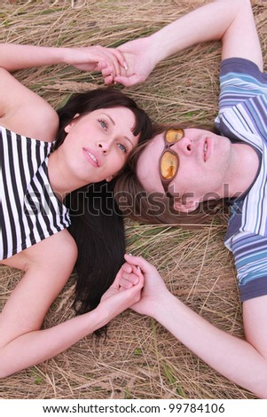 couple in the park relaxing on their backs