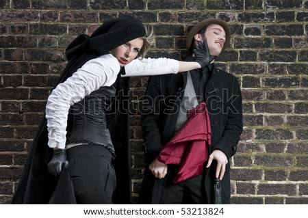 Couple in victorian costumes, woman strangling man.