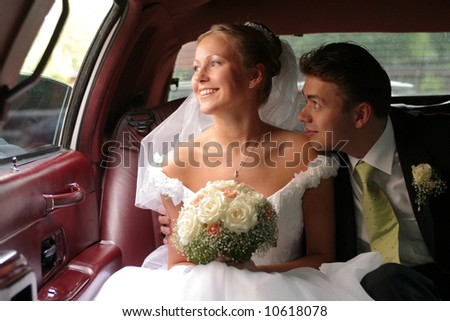 Couple in wedding car limo