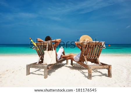 Couple in white relax on a tropical beach at Maldives #181176545