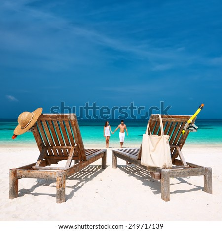 Couple in white walking on a tropical beach at Maldives #249717139