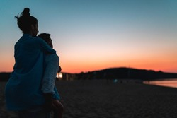 Couple inlove at beach with sunset