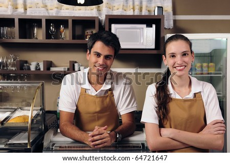 Couple is owner of a cafe or waitress and waiter working