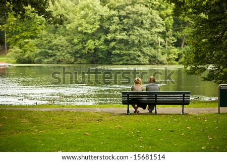 Couple is sitting in a park and enjoying the view