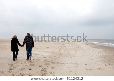 Couple is walking on the beach